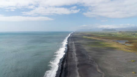 Endless volcanic black sand beach located in Vik, Iceland