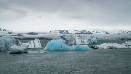View of icebergs in Jokulsarlon glacier lagoon formed with melting ice, Iceland, global warming and climate change concept Zdjęcie Seryjne