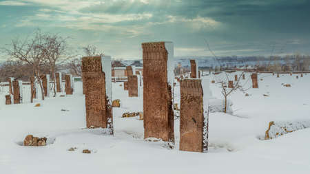 Historical Ahlat Seljuk Square Cemetery with islamic tombstones during winter under snow Zdjęcie Seryjne