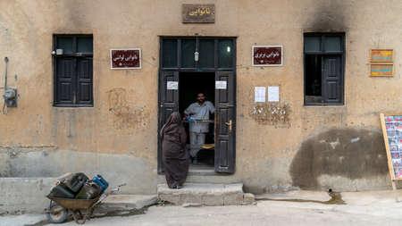 Masuleh, Iran - May 2019: Iranian woman buying bread from local bakery