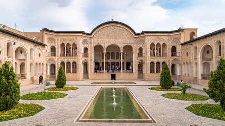 Kashan, Iran - May 2019: Tourists visiting Tabatabaei Natanzi Khaneh Historical House. Wonderful Persian architecture. Kashan is a popular tourist destination of the Middle East. Publikacyjne