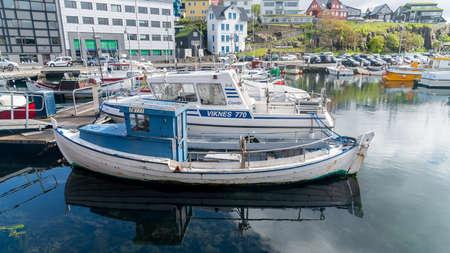 Torshavn, Faroe Islands - August 2019: Fishing boats in Torshavn marina harbour on Faroe islands.