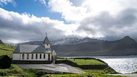 Vidareidi, Faroe Islands - August 2019: Vidareidi village with village's church, Vidoy island, Faroe Islands, Denmark.