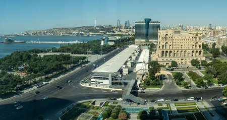 Baku, Azerbaijan - July 2019: Baku cityscape with Caspian Sea, Flame Towers and car traffic Publikacyjne