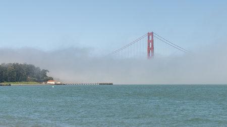 San Francisco, USA - August 2019: Golden Gate Bridge under fog, with one tower visible. The Golden Gate Bridge is a suspension bridge spanning the Golden Gate. Publikacyjne