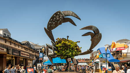 San Francisco, California, USA - August 2019: Fisherman's Wharf entrance with a crab statue. Fisherman's Wharf is a major tourist attraction in San Francisco.