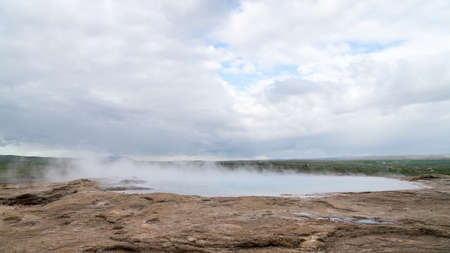 Strokkur geothermal landscape in Iceland with hot water and smoke, Strokkur, Iceland. High concentration of volcanoes is often an advantage in the generation of geothermal energy in Iceland Zdjęcie Seryjne