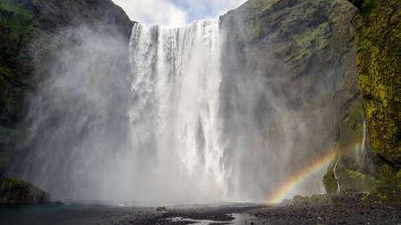 Huge waterfall of Skogafoss with a rainbow, Skogar, south of Iceland