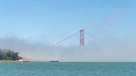 San Francisco, USA - August 2019: Golden Gate Bridge under fog, with one tower visible. The Golden Gate Bridge is a suspension bridge spanning the Golden Gate. Zdjęcie Seryjne