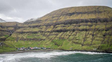 Village of Tjornuvik on Streymoy and dramatic mountain landscape on the Faroe Islands, Denmark, Europe