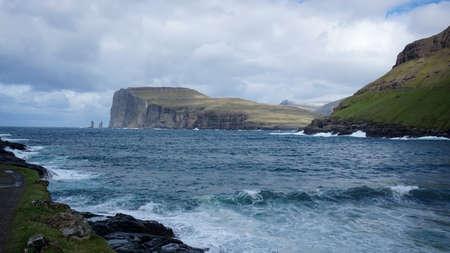 Risin and Kellingin rocks as seen from Tjornuvik bay with waves hitting the shore on Streymoy on the Faroe Islands, Denmark, Europe Zdjęcie Seryjne