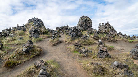 Stone towers on a lava field called Laufskalavarda in southern Iceland. Cairns made of stones symbolize good luck and peace