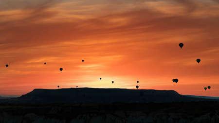 Cappadocia, Turkey - Silhouettes of hot air balloons flying in Cappadocia landscape with dramatic morning sky, Turkey Zdjęcie Seryjne