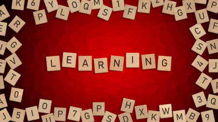 Top view of word Learning written with wooden letters with scattered alphabet letters in background