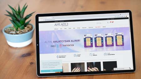 Istanbul, Turkey - July 2021: Illustrative Editorial of Turkish Ahlatci Kuyumculuk website homepage. Ahlatci Kuyumculuk logo visible on a tablet screen.