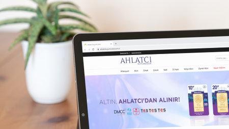 Istanbul, Turkey - July 2021: Illustrative Editorial of Turkish Ahlatci Kuyumculuk website homepage. Ahlatci Kuyumculuk logo visible on a digital screen close-up
