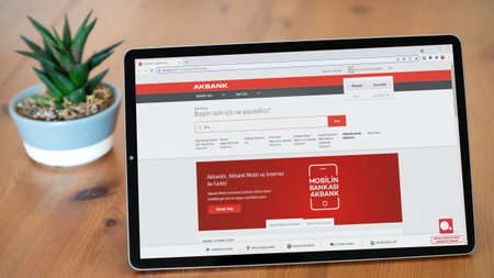 Istanbul, Turkey - July 2021: Illustrative Editorial of Turkish Akbank website homepage. Akbank logo visible on a tablet screen.