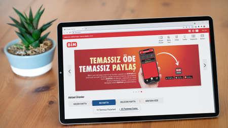 Istanbul, Turkey - July 2021: Illustrative Editorial of Turkish BIM Market website homepage. BIM Market logo visible on a tablet screen.