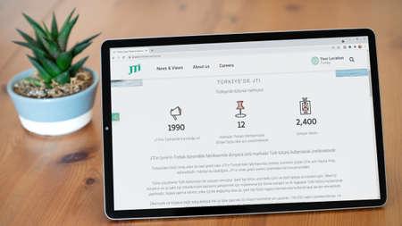 Istanbul, Turkey - July 2021: Illustrative Editorial screenshot of Turkish JTI Tutun Tobacco website homepage. JTI Tutun Tobacco logo visible on a tablet screen. Publikacyjne
