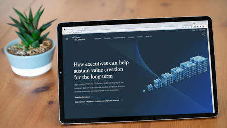 Istanbul, Turkey - July 2021: Illustrative Editorial screenshot of McKinsey and Company website homepage. McKinsey and Company logo visible on a tablet screen.