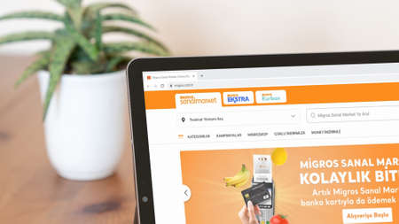 Istanbul, Turkey - July 2021: Illustrative Editorial screenshot of Turkish Migros website homepage. Migros logo visible on a digital screen close-up