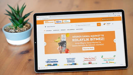 Istanbul, Turkey - July 2021: Illustrative Editorial screenshot of Turkish Migros website homepage. Migros logo visible on a tablet screen.