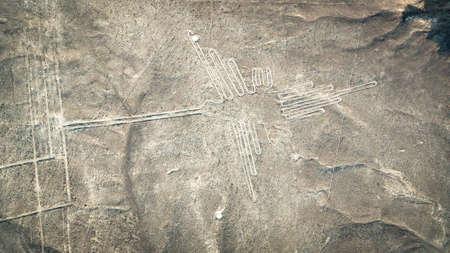The Hummingbird Nazca ancient mysterious geoglyph. Nazca lines as seen from the aircraft. Nazca lines are landmarks of Peru Zdjęcie Seryjne