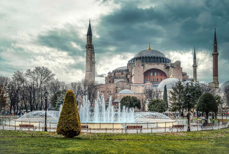 Istanbul, Turkey - January 12, 2013: Hagia Sophia mosque dome and minarets in Sultanahmet square under dramatic clouds Publikacyjne