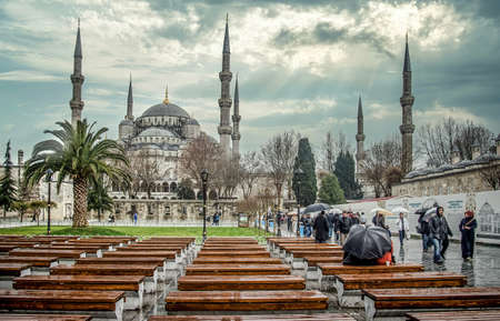 Istanbul, Turkey - January 12, 2013: Sultanahmet Mosque, also known as the Blue Mosque minarets in Sultanahmet square under dramatic clouds Publikacyjne