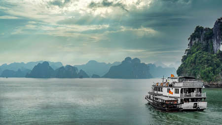 Halong Bay, Vietnam - December 2015: Cruise boat sailing in Halong Bay. Halong bay is a famous destination of Vietnam Publikacyjne