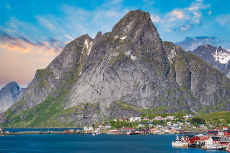Reine, Lofoten, Norway - June 2016: The village of Reine under a sunny, blue sky, with the typical rorbu houses