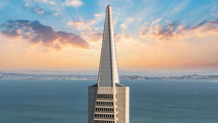 San Francisco, California, USA - August 2019: Transamerica Pyramid tower top floors during sunset