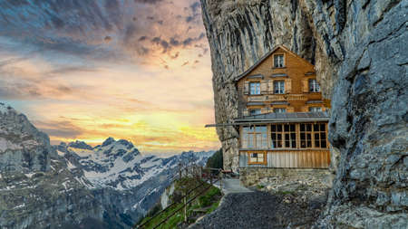 Ebenalp, Switzerland - May 2017: Famous mountain guesthouse Aescher in the middle of the hiking trail, Aescher Wildkichi. Ebenalp is an attractive recreation region for hiking, climbing, skiing and paragliding Publikacyjne