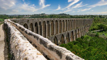 Tomar, Portugal - April 2018: Pegoes aqueduct by the Castle and Convent of the Order of Christ