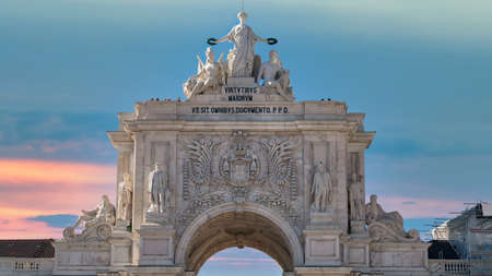 Lisbon, Portugal - April 2018: Looking up at the iconic Augusta Street Triumphal Arch in the Commerce Square, Praca do Comercio or Terreiro do Paco.