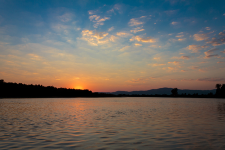 Sunrize on a wide river Tisa in summer