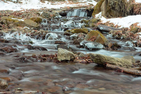 Flowing water of Carpathian mountain stream. Ukraine,Transcarpathia