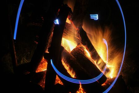 outdoor fireplace: Campfire in fire pit at campsite.May 27.Ukraine Stock Photo