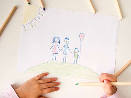 Drawing of happy family on white table