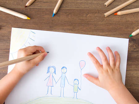 Child drawing happy family