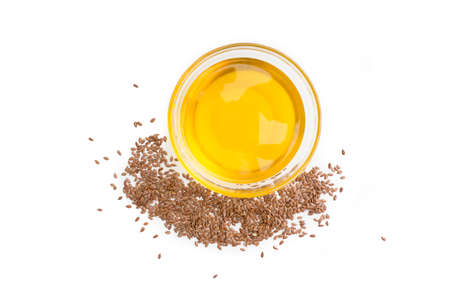 Flaxseed (linseed) oil isolated on white background, studio shot
