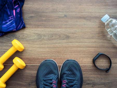 Healthy lifestyle concept with sports equipment on dark wooden background, top view Standard-Bild - 105978233