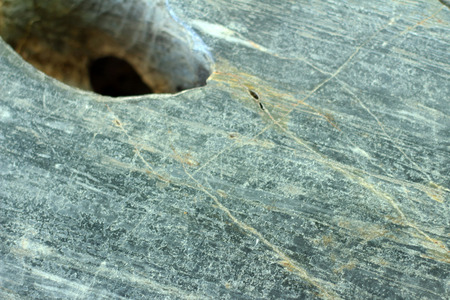 gunfire: Hole on the marble wall