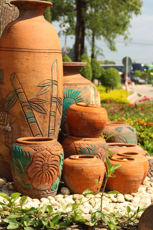 earthen: Earthen jars water and coconut shells