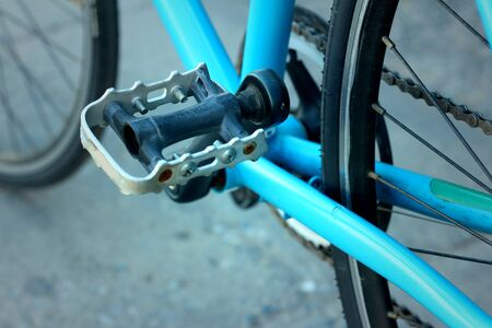 Footrest of bikes parked in the park. Stock Photo