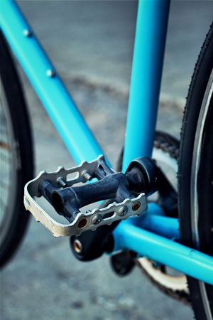 footrest: Footrest of bikes parked in the park. Stock Photo
