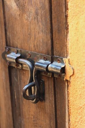 antique keyhole: lock of the door locked with padlock.
