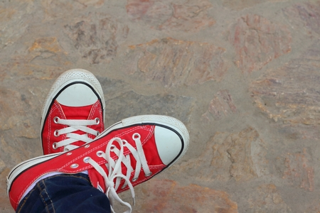 Red shoes on the background of the cement. Stock Photo - 41905927