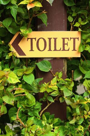 gent's: Signs to the toilet in the garden. Stock Photo