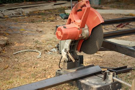 cutoff blade: Mechanic cutting a steel at the park
